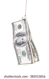 Close-up of american dollar banknote attached on fish hook, isolated on white background.