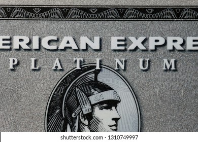 Closeup of American Express Platinum credit card. Symbol of modern wealth and financial business. Photographed in Kuopio, Finland during February 2019.