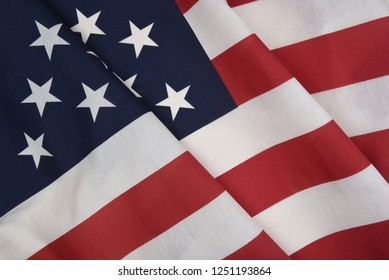 Closeup of an American Flag with folds, for patriotic holiday themed projects.