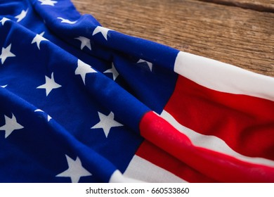 Close-up of an American flag on a wooden table