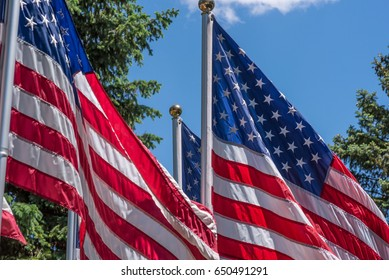 Closeup of American flags waving in the sunlight