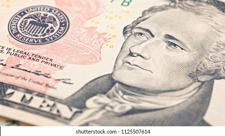 Closeup American money  twenty dollar bill. Alexander Hamilton portrait, US 10 dollar banknote fragment macro.