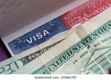 Close-up of american visa stamp covered with dollar currency paper