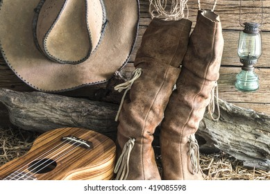 Closeup american west rodeo brown felt cowboy hat and traditional leather boots with ukulele in vintage ranch barn background, Still life style