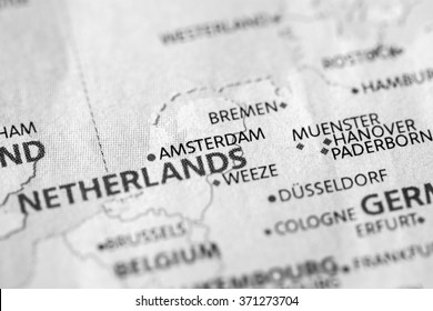 Closeup of Amsterdam, Netherlands on a political map of Europe. (black and white)