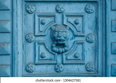 closeup of ancient luxury door with lion sculpture