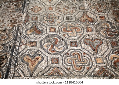 Close-up of ancient mosaic on the street of Roman Archaeological site of Ephesus, Izmir,Turkey.