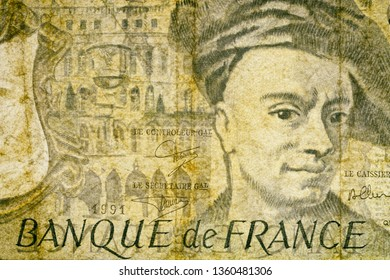 Close-up at an ancient, outdated fifty Francs French banknote. Details of fiber paper, with all flaws, watermarks and traces of usage.