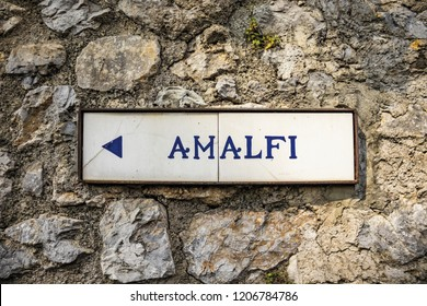 close-up of an ancient road sign of Ravello, indicating the direction to Amalfi. In the province of Salerno, on the Amalfi coast.