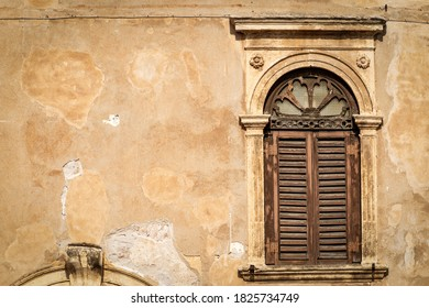 Close-up of an ancient window with arch and columns in Verona downtown. UNESCO world heritage site, Veneto, Italy, Europe.