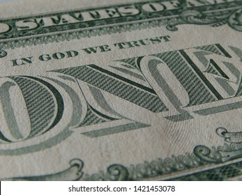 "Close-up Of Angled View Featuring ""In God We Trust"" Included In The Design On Back Of US One Dollar Bill"