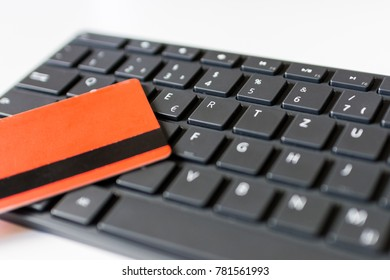 Closeup angled view shot of a credit card on a keyboard. Just about to enter pin code