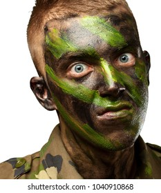 closeup of angry soldier with painting against a white background