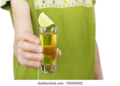 Close-up of anonymous woman in traditional Mexican outwear holding shot of tequila.