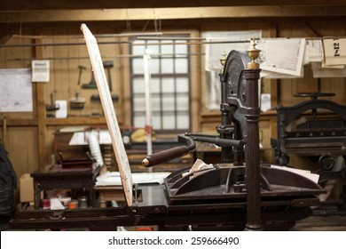 Close-up of antique letterpress printing machine