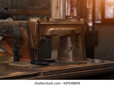 Close-up of antique sewing machine.