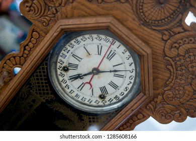 Closeup of antique wooden clock