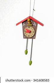 Closeup of antique wooden cuckoo clock Christmas Tree Ornament isolated on white.