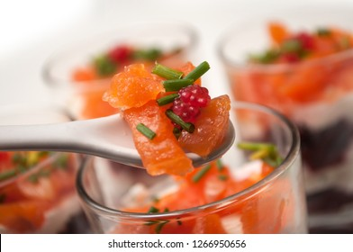 closeup of appetizers in little glasses on white background