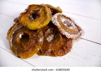 Closeup of apple candied fruits on the white wooden surface