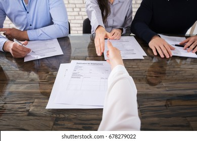 Close-up Of An Applicant Shaking Hand With Corporate Recruitment Officers In Office