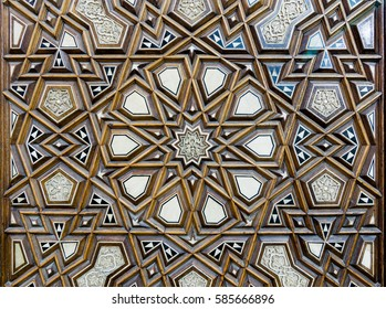 Closeup of arabesque ornaments of an old an aged decorated wooden door, Old Cairo, Egypt