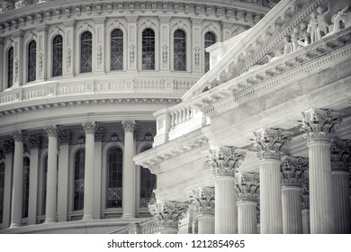 Close-up architectural detail view of the US Capitol Building dome with ornate classical columns of the exterior of the Senate building in Washington DC, USA
