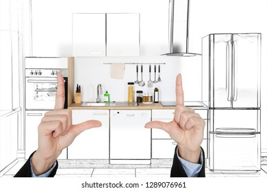 Close-up Of An Architecture's Hand Presenting Design Of Kitchen Interior