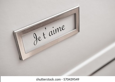 """closeup of archive cardboard with sticker with word """"je t'aime"""" ( I Love You)"""