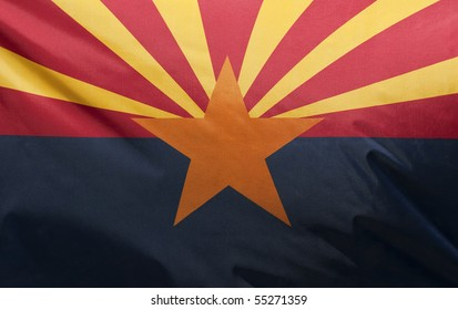 A close-up of the Arizona state flag waving in the wind.
