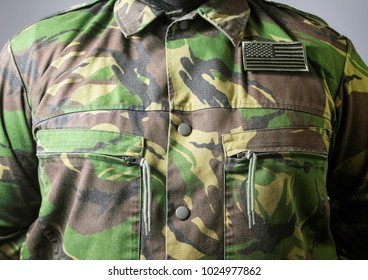 Closeup army uniform. Closeup photo of a  male chest standing in military jacket.