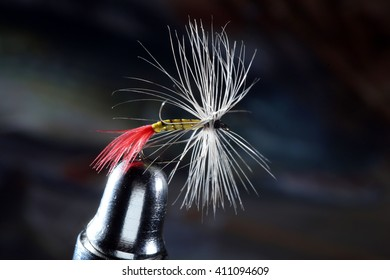 close-up of an artificial fly bait on a dark background studio