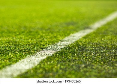 Close-up of artificial soccer pitch on a sunny day.