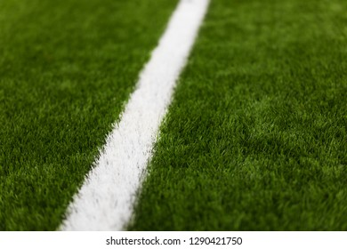 Close-up of artificial turf of soccer pitch. Soccer football field detail