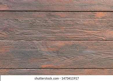 Close-up of artificial wooden plank wall background.