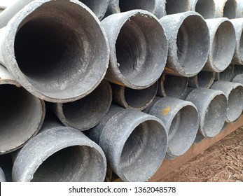 Close-up of asbestos pipes on construction site.