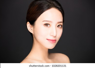 closeup asian beauty face isolated on black background