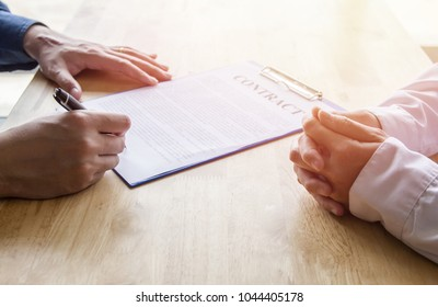 Close-up. Asian business of hand holding pen reviewing and signing,Home buying contract,Selective focus