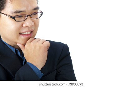 Close-up of a Asian businessman thinking.