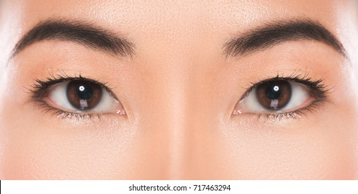 Close-up of Asian eyes. Eye care and beauty.