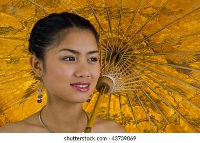close-up of an asian girl carrying an umbrella