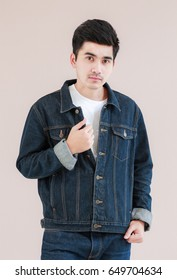 Closeup Asian man casual outfits standing in jeans and black denim shirt, men black hair and short hair, smiling and wearing jeans jacket, beauty and fashion concept, and Jeans concept
