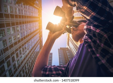 Close-up Of Asian man Hand Holding / looking / watching using Binoculars with copyspace, Looking at the vision of business people 