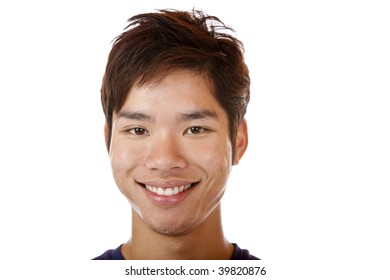 Closeup of Asian man smiling happy into camera. Isolated on white.