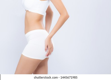 Closeup asian woman beautiful body diet with fit and hand touch bottom isolated on white background, model girl weight slim and butt with cellulite or calories, health and wellness concept.