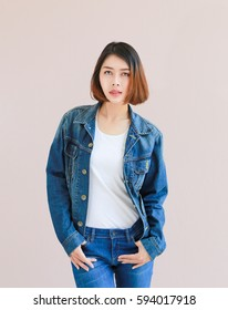 Closeup Asian woman casual outfits standing in jeans and blue denim shirt, women brown hair and short hair, smiling and wearing jeans jacket, beauty and fashion concept, Jeans concept