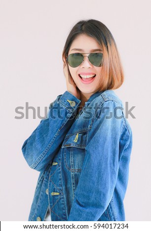 5506a0df32 Closeup Asian woman casual outfits standing in jeans and blue denim shirt