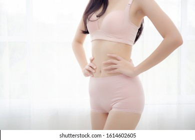 Closeup asian woman wear underwear beautiful body belly slim shape sexy with diet at room, model asia girl wear bra hand touch abdomen thin with weight loss, health and wellness concept.