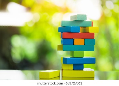 Close-up of asian woman's hand playing wood blocks stack game with copyspace, Learning and Education Background concept.