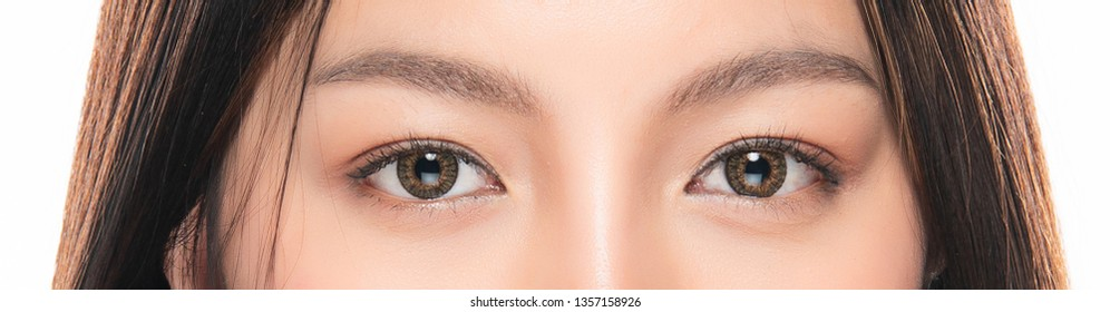 Close-up Asian Women's eyes on White Blackground